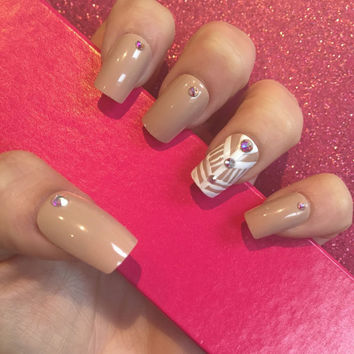 Luxury Hand Painted False Nails. Square nude nails with Swarovski crystals and hand painted accent nail.
