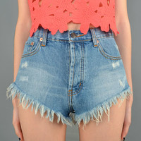 Have some fun in the sun with the Fringe Hemline High Waist Denim Shorts. Featuring a blue denim construction, 5 pocket design, belt loops, zip fly, single button closure, and finish with fringe hemline.