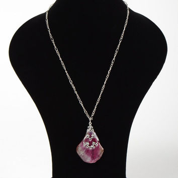 Handmade pendant on long chain with flower petal coated with epoxy resin
