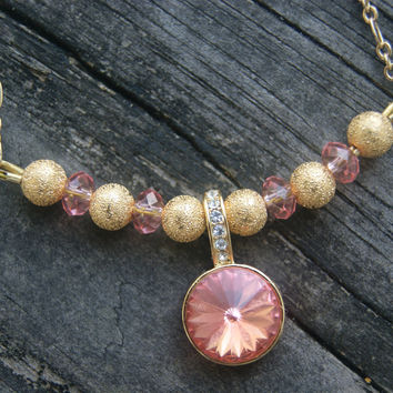 As Seen on Law and Order:SVU  Rose Peach Swarovski Crystal and Golden Stardust Bead Bar Necklace