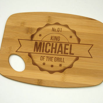 "King Of The Grill with Name Bamboo Cutting Board 9"" by 12"", Laser cut engraving on wood designed to your needs"