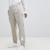 adidas Originals Adibreak Cuffed Trackpants In Beige at asos.com