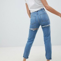 ASOS DESIGN Farleigh high waist slim mom jeans in light stone wash with bum rips at asos.com