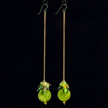 green & gold cluster earrings // mixed shell, glass, Swarovski, plastic, ceramic, beads on gold toned chain // long earrings