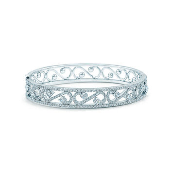 Tiffany & Co. - Tiffany Enchant® scroll bangle in platinum with diamonds, size medium.