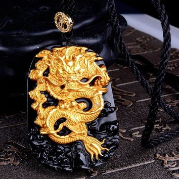 A Gold and Obsidian Dragon Pendant