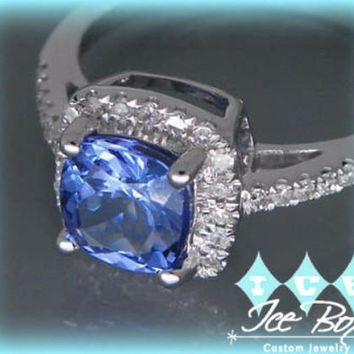 A 1.2ct Cushion Cut Tanzanite Vintage Engagement Ring in a 14K White Gold Diamond Halo Setting