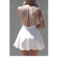 Dower Me Pure V neck mini robe retour tassel femmes sexy push up volants robes de white strappy back sleeveless skater dress