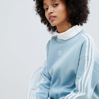 adidas Originals adicolor Three Stripe Sweatshirt In Blue at asos.com