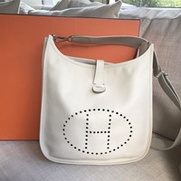 HERMES Evelyne III 33 GM shoulder bag in Veau Epsom White