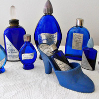 Vintage and Very Collectible Hard To Find  Bourjois Blue High Heel Shoe Holding Bottle of  Evening In Paris Soirde Paris