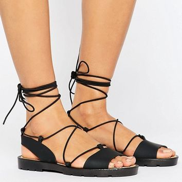 ASOS FLUTTER Tie Leg Jelly Sandals at asos.com