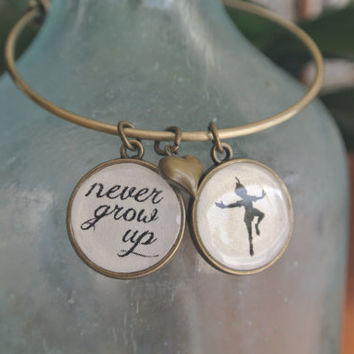 Peter Pan, Never Grow Up Bracelet on a adjustable bangle.  Available in antique gold or silver
