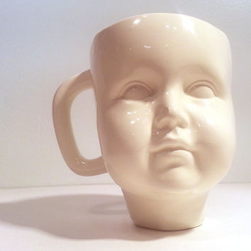 Handmade Ceramic Baby Face Mug. Altered vintage molds create modern coffee cup in fun colors. Perfect creepy cute gift.