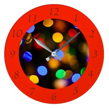 Multicolored Christmas lights. Arabic numerals. Large Clock