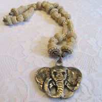 Tan Wooden Bead Necklace with Silver Elephant Charm