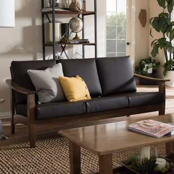 Baxton Studio Pierce Mid-Century Modern Walnut Brown Wood and Dark Brown Faux Leather 3-Seater Sofa Set of 1