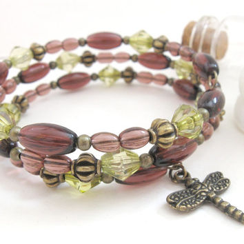 Violet bracelet, green beads and bronze dragonfly