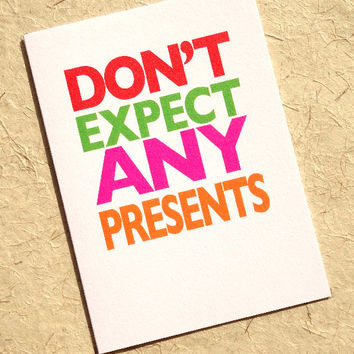Funny christmas card, don't expect any presents, this light-hearted design is an explosion of colour, also great for birthdays, holiday card
