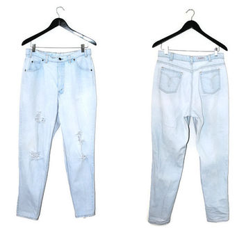 washed out mom jeans 80s 90s pale faded high waisted light wash denim shredded tapered jeans size 31
