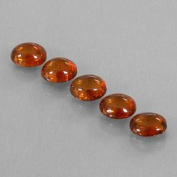 4.33 ct (total) Oval Cabochon Orange Spessartite Garnet 6.1 x 5.1 mm