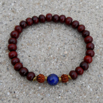 Beauty and compassion,  rosewood mala bracelet with genuine lapis lazuli guru bead