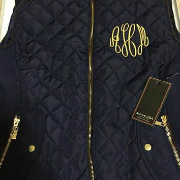 Black Monogrammed Puff Vest. Limited quantities available. Great addition to your fall wardrobe or a gift.