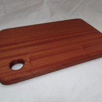 Hardwood chopping board,serving board cheese board made from sapele with a finger hole for easy carrying of the item