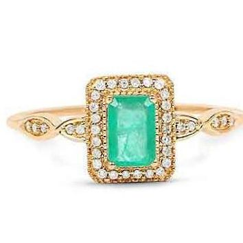 A Special Edition 14K Gold .75CT Emerald Cut Natural Zambian Emerald Halo Diamond Ring