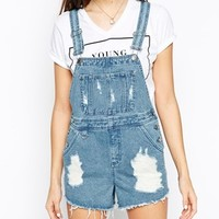 ASOS Denim Dungaree Short in Vintage Mid Wash With Raw Hem at asos.com