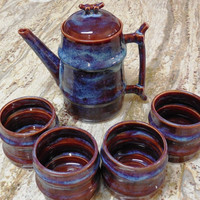 Handmade Pottery Teapot set with four cups in deep red and blue combination glazes on white stoneware