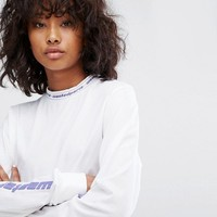 Wasted Paris Long Sleeve Skate Top With With Worldwide Sleeve And Neck Print at asos.com