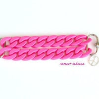 bright pink acrylic double strand bracelet with peace charm