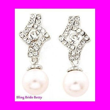 Lovely Cream Faux Pearl Drop Bridal Earrings on Silver Tone  Silver Tone