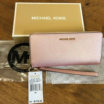 Authentic Michael Kors Jet Set Travel Rose Gold Wrislet Purse Wallet