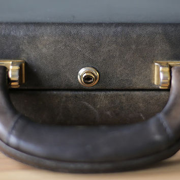 vintage leather suitcase by Ventura