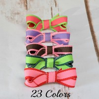 Mini lollipop ribbon hairbows in 23 fun colors. Small baby hair bows are 1.5 inches and come on a snap clip with a no slip grip. Your Final Touch Hair Accessories