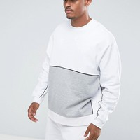 ASOS Oversized Sweatshirt With Cut & Sew & Piping at asos.com