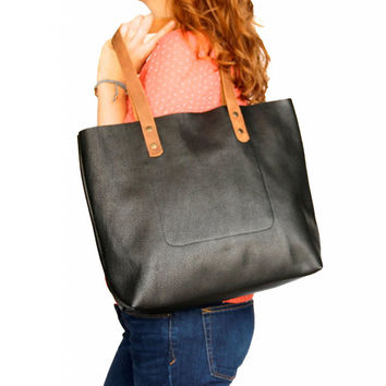 Large black leather handbag by Leah Lerner