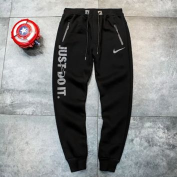 NIKE New fashion hook letter print sports leisure thick keep warm couple pants Black
