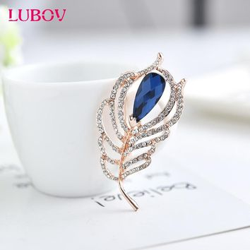 Shining Rhinestones Inlaid Golden Metal Frame Feather Brooch Pin with Big Blue Crystal Stone Luxury Women Party Brooches 2018