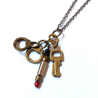 handcuffs, red future sonic screwdriver, and key necklace