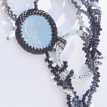 Beaded necklace silver - black 150 Lire
