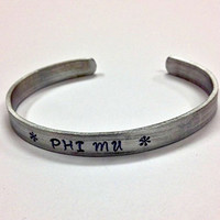 Phi Mu Cuff Bracelet - handstamped in a whimsical font on a non tarnish aluminum cuff, officially licensed