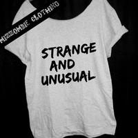 STRANGE and UNUSUAL Tshirt, Off The Shoulder, Over sized,   loose fitting, graphic tee, grunge, regular and plus size