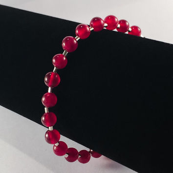 Garnet beaded bracelet .. Red gemstone bead bracelet with silver plated tube beads and a magnetic clasp