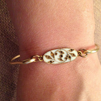 Brass Bangle Bracelet with Floral Medallion