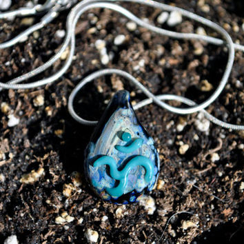 Blown Glass OM / AUM pendant , black and turquoise galaxy Boro blown glass