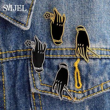 Trendy SMJEL Gothic Men Black Witch Hand Brooch Handle Rose Hand Knife Dagger Punk Enamel Pins Denim Jacket Badge Friends Doctor Gifts AT_94_13