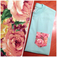 Mint Green Floral Pocket Tee. Size: Unisex Adult Small, Medium, Large, Extra Large